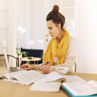 Optimized-young-university-student-busy-with-studying-PFEWKJ4
